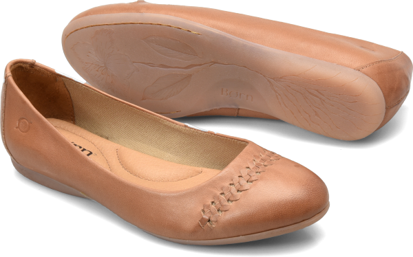 We believe in two things when it comes to designing: comfort and details. A charming woven detail around the toes defines this hand-finished flat.   Full-grain leather upper  Leather lining  Rubber outsole  Opanka handcrafted construction  Heel Height: 1/2 inch