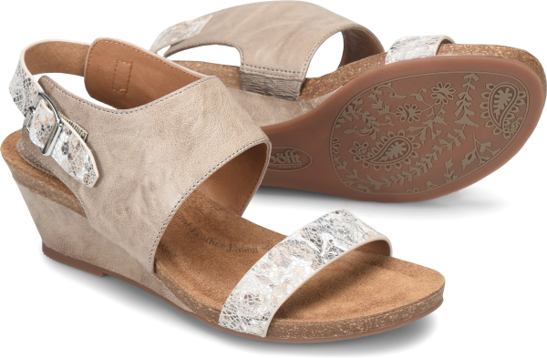 One of our best-selling low wedges, the Vanita has a super-comfortable suede footbed, molded to follow the natural shape of the foot.   Italian full-grain leather with printed leather flower accents  Also offered in full-grain leather or metallic leather  Adjustable buckle  Leather lining  Molded cork midsole and suede lined footbed with soft foam padding  CPE outsole with a wrapped wedge  Heel Height: 2 1/4 inches